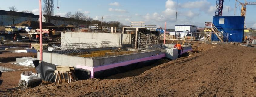 Neubau einer Wohnanlage mit 15 Reihenhäusern und Tiefgarage